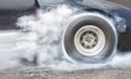 Drag racing car burns rubber off its tires for race Royalty Free Stock Photo
