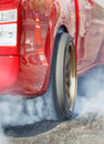 Drag racing car burns  tire for the race Royalty Free Stock Photo
