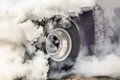 Drag racing car burns tires for the race Royalty Free Stock Photo