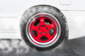 Drag racing car from side tire burnout in preparation for the ra Royalty Free Stock Photo