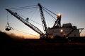 Dragline on mining site at night Stock Image