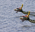Dragon boats focus on foreground boat Royalty Free Stock Images