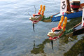 Dragon boats wait for next race in grand marais minnesota the harbor on lake superior at Royalty Free Stock Photo