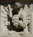 Dragon depicted on the walls of pedestal of the sculpture Royalty Free Stock Images
