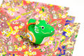 Dragon Figurines and gaily colored paper. Stock Photo
