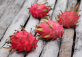 Dragon fruits on organic surface Royalty Free Stock Photo