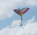 Dragon kite soaring beautiful colorful in a beautiful blue sky with clouds Stock Image