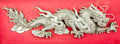 Dragon made ​​of steel plate on read background Stock Images