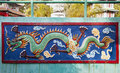 Dragon relief at haw par villa singapore february colorful wall sculpture theme park this theme park contains over statues and Stock Photography