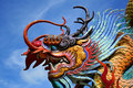Dragon sculpture in thailand blue sky background Stock Photo