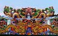 Dragon statue flying Chinese temple roof in Thailand Royalty Free Stock Photo