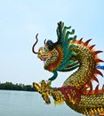 Dragon in temple near river with blue sky Stock Image