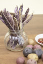 Dragon Tongue Beans bunched in a jar with small mini potatoes an Royalty Free Stock Photo