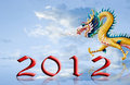 Dragon walking with 2012 year number on the sky Royalty Free Stock Photo