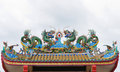 Dragons statue on the roof of Chinese temple Royalty Free Stock Images