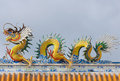 Dragons statue on the roof of Chinese temple Royalty Free Stock Image