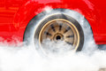 Dragster Car Burn Out Rear Tyre With Smoke. Royalty Free Stock Photo