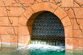 Drainage gate on old building Royalty Free Stock Photo