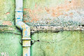Drainpipe an old metal on a weathered stone wall Royalty Free Stock Images