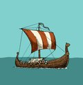 Drakkar floating on the sea waves.
