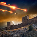 Dramatic background old fortress tower under attack dark stormy sky asteroid meteorite impact Stock Photography