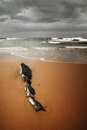 Dramatic beach scene with black rocks vignette focus on rocks Royalty Free Stock Photography