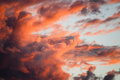 Dramatic clouds lit by the setting sun Stock Photo