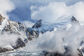 Dramatic clouds and peaks in the alps summer Stock Photography