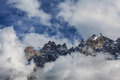Dramatic clouds and peaks in the alps summer Royalty Free Stock Photo