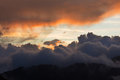 Dramatic cloudscape clouds sunset over mountains Royalty Free Stock Photo