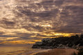 Dramatic cloudscape over beach at sunset. Royalty Free Stock Photo