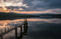 Dramatic cloudy sunset by a lake Royalty Free Stock Photo