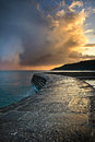 Dramatic coastal sunset a passing storm catching the evening sun light Royalty Free Stock Images