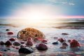 Dramatic colorful sunset on a rocky beach. Baltic sea Royalty Free Stock Photo