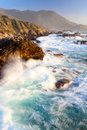 Dramatic Crashing Waves at Sunset on Big Sur coast, Garapata State Park, near Monterey, California, USA Royalty Free Stock Photo