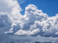 Dramatic cumulus clouds against a blue sky with snow cap mountains of hurricane ridge washington Stock Photography