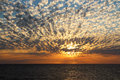 Dramatic cumulus clouds at sunset over the ocean Stock Photo