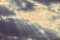 Dramatic faded sky with dark clouds and streaming lights Stock Images