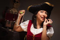 Dramatic Female Pirate Biting A Coin Royalty Free Stock Photography