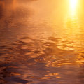 Dramatic golden sky reflected in water natural landscape with Royalty Free Stock Images