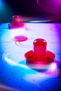 Dramatic lit air hockey table with light trails