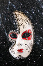 Dramatic and mysterious half moon carnival mask and black glitter background Royalty Free Stock Photo