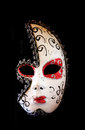 Dramatic and mysterious half moon carnival mask isolated on black Royalty Free Stock Photo