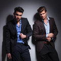 Dramatic picture of two fashion male models looking at the camera Royalty Free Stock Image