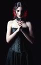 Dramatic portrait of beautiful goth woman among the dark Royalty Free Stock Photo