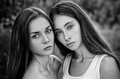 Dramatic portrait of a girl portrait of two beautiful girls in the woods studio Royalty Free Stock Photos