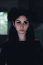 Dramatic portrait of a young beautiful girl. A girl with a pleasant appearance and sad look. Creative portrait of a woman. Attract Royalty Free Stock Photo