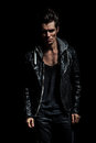 Dramatic portrait of a young man in leather jacket Royalty Free Stock Photo