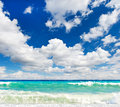 Dramatic sea over beautiful blue sky Royalty Free Stock Image