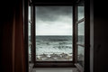 Dramatic sea view from opened window with big stormy waves and dramatic sky during rain and storm weather in fall season on sea co